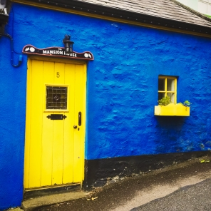 I live in the blue house with the yellow door